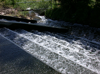 Water flowing down steps in the post aeration phase of wastewater treatment